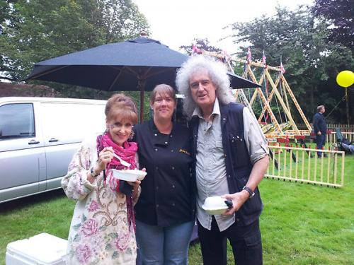Brian May and Anita Dobson enjoying  Juicy Jackets